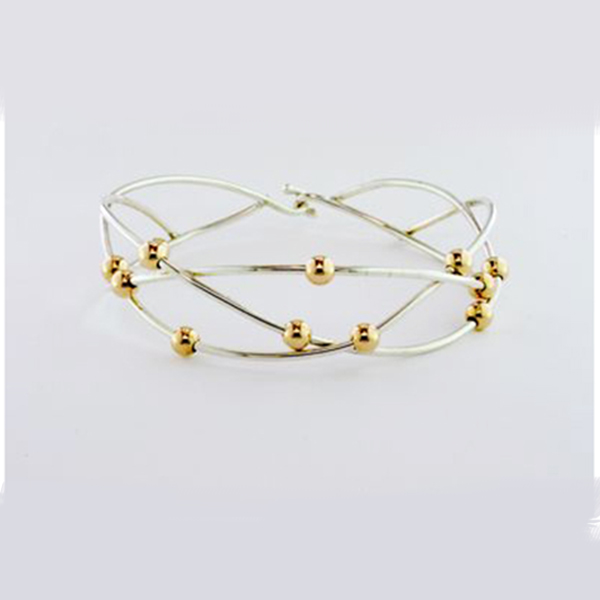 Silver weave bracelet with moving gold-fill ball by Tom Kruskal